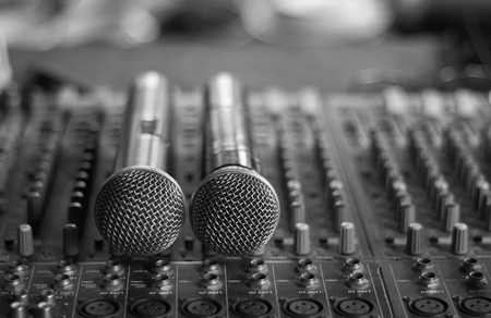 audio mixer: Close up of microphones put on sound music mixer control panel. Stock Photo