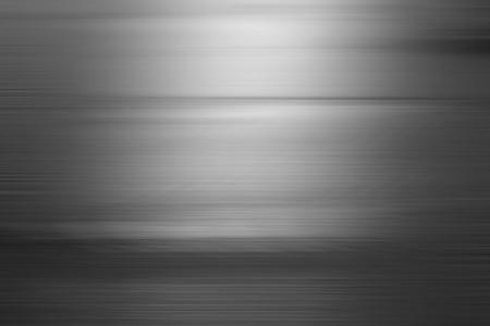 グレーのグラデーションでは、抽象的な背景がぼやけています。 写真素材