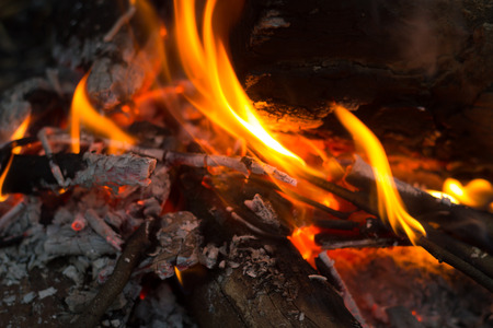 smolder: flames of fire from charcoal and wood.