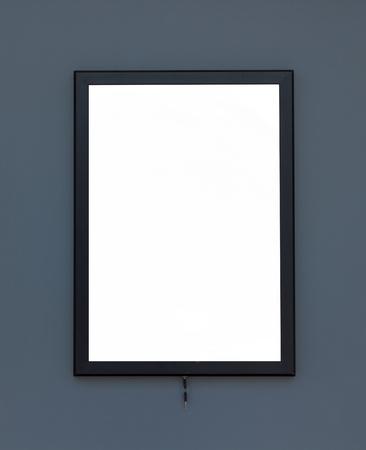 advertize: White billboard gray wall.