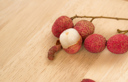 litchee: Fresh lychee on a wooden background.