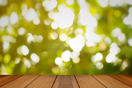 Wooden board with Natural green blurred background.