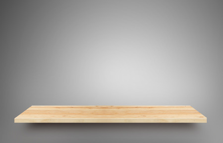advertize: Wooden shelf with gray gradient background. Its display for present product. Stock Photo