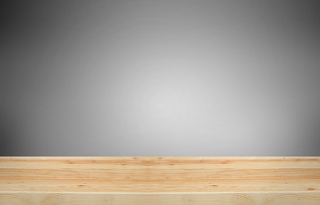 advertize: Wooden table with gray gradient background. Its display for present product.