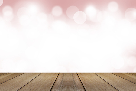 dreamlike: Wooden board with Abstract Blurred pink tone lights background.