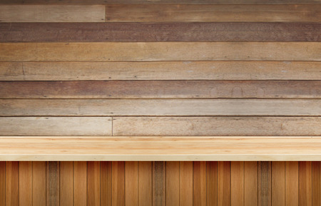 advertize: Wooden table display for present product with woodwall background.