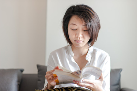 editions: Reading the book, young beautiful girl reads book Stock Photo