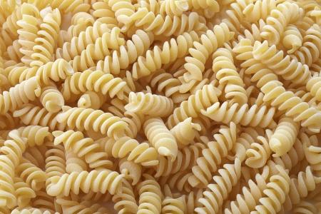 fusilli: Fusilli pasta background Stock Photo
