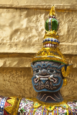Face of green demon guardian sculpture protect gold pagoda in Wat Phra Keaw,Bangkok Thailand photo
