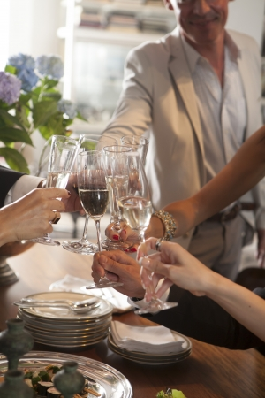 Hands of people toasting in party photo