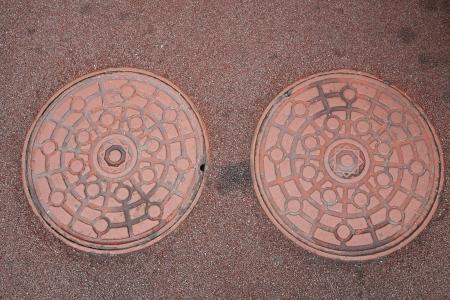 metal grate: Twin Manhole cover on ground,Seoul,Korea