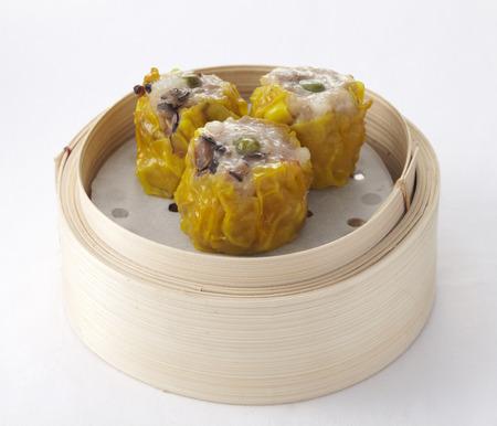 Chinese mushroom dumplings in a bamboo steamer photo