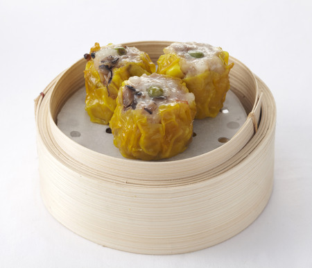 sum: Chinese mushroom dumplings in a bamboo steamer