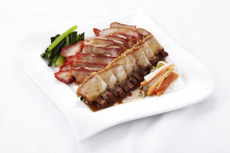 Chinese style roasted pork on white background