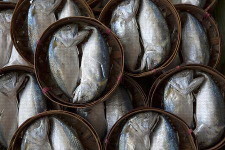 Streamed mackerel in bamboo basket photo
