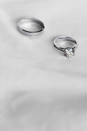 Two wedding ring on white fabric background