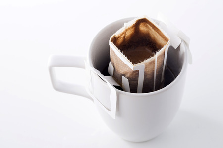 Instant freshly brewed cup of coffee,Drip bag fresh coffee Фото со стока - 34142910