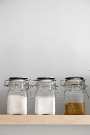 brown sugar: Salt,flour and brown sugar in storage on shelf Stock Photo
