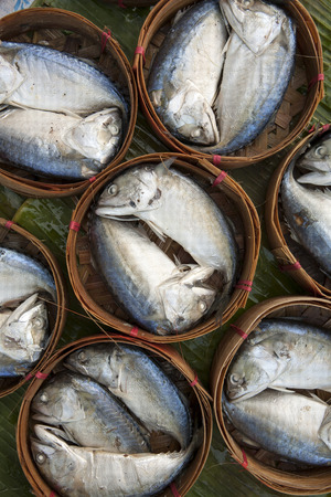 Streamed mackerel in bamboo basket photo