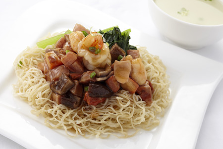 stir fried: Egg noodle topped with stir fried ham and seafood Stock Photo