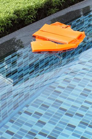 lifejacket: Life-jacket in swimming pool Stock Photo