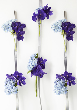 orchid house: Hydrangea and orchid hanging on wall Stock Photo