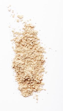 Finishing face powder on white background