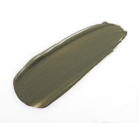 mascarilla: Gris golpe crema exfoliante barro en blanco Foto de archivo