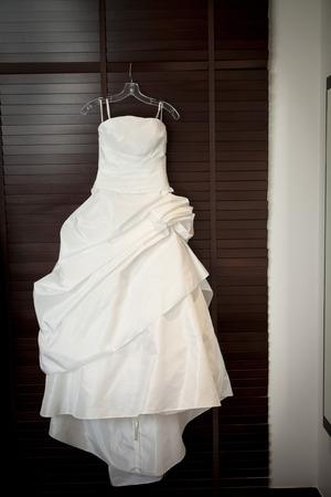 closet door: Wedding dress hang on closet door Stock Photo