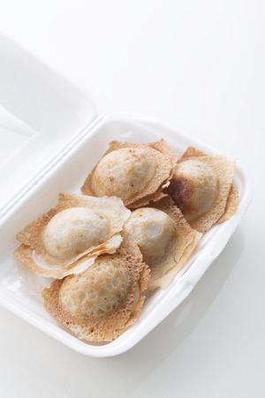 foam box: Sweet and Savory Grilled Coconut-Rice Hotcakes,Coconut Rice Cake,Thai coconut pudding Stock Photo