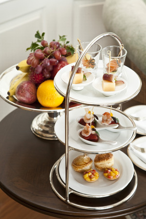 for tea: Canapes and fruits for afternoon tea Stock Photo
