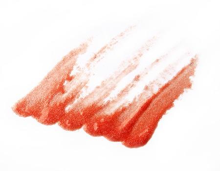 brush stroke: Orange lip gross brush stroke on white background