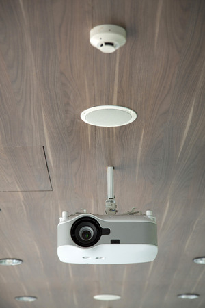 Projector hang on wooden ceiling photo