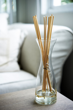 perfume bottle: Scent sticks aromatic in jar on table
