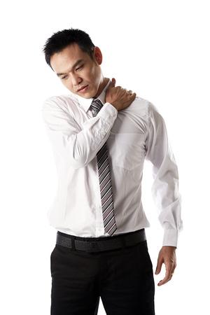 Asian businessman have his shoulder hurt
