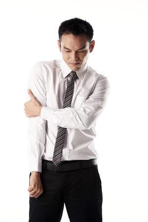 Asian businessman have his arm hurt Фото со стока