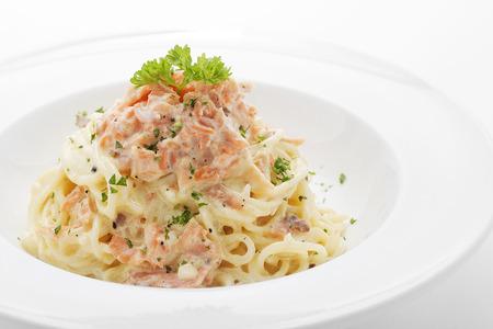 Spaghetti salmon cream sauce,close up