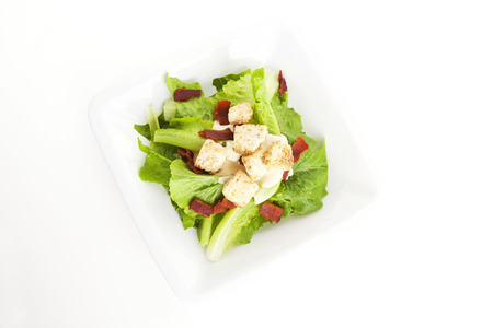 bacon bits: Caesar salad on background,top view Stock Photo