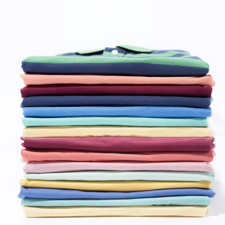 Stack of colourful t-shirts