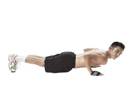 Asian man push up exercise on white background Фото со стока