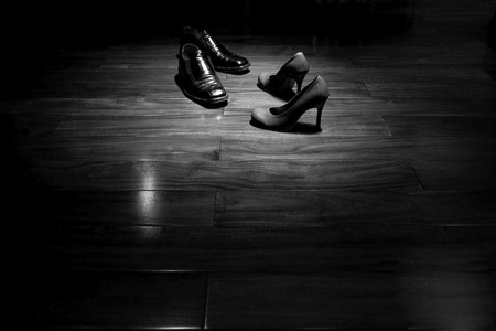 Couple shoes on dance floor in black and white