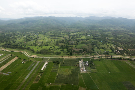 ariel: Ariel view of rice field and mountain in Chiangmai, Thailand