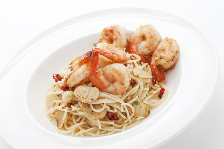 stir up: Spaghetti stir fried with shrimps and garlics,close up Stock Photo