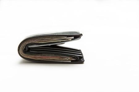 Wallet full of money on white background