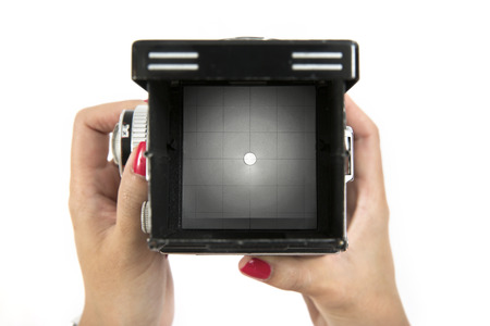 viewfinder vintage: Viewfinder on vintage medium format camera with hand holding