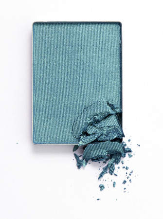 Green color eyeshadow cracked on background