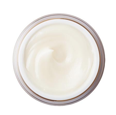 tratamientos corporales: Cierre de crema de belleza en el fondo con trazado de recorte Foto de archivo
