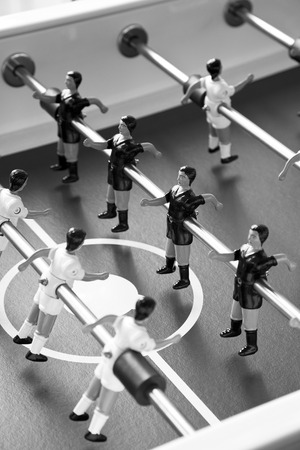 foosball: a row of foosball or table soccer playing pieces Stock Photo