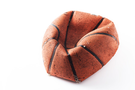 basket ball: Old damaged rubber basket ball on background