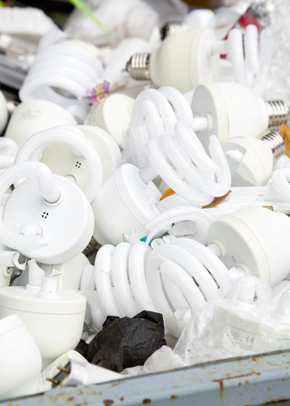 junkyard: Damage light bulb in junkyard,close up